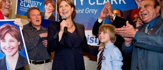 Supporters cheer as B.C. Premier Christy Clark, centre left, and her son, Hamish, celebrate her byelection win in the riding of Vancouver-Point Grey on Wednesday. (Darryl Dyck/Canadian Press)